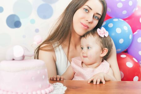 wish desire: Mother with funny baby celebrating first bithday. Cake is surprise for child. Make a first wish. Desire. Funny