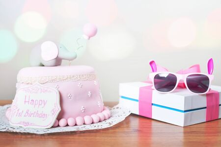 wish desire: Celebrating first birthday. Cake and gift. Happy 1st birsday, one year. Surprise for child. Make a first wish. Desire.