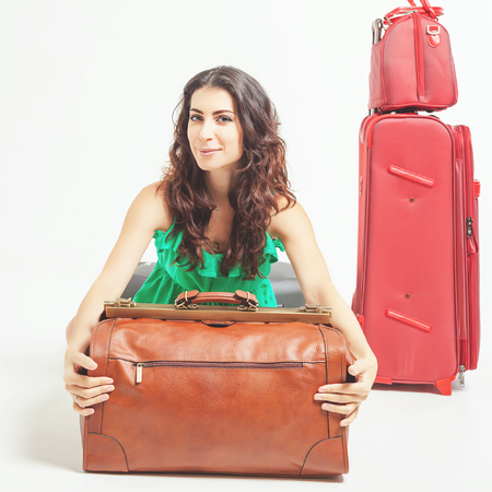 cary: Surprised woman holding hand luggage at the airport terminal. Suitcase sale. Tourism. Vintage tourist bag. Passenger. Airlines. Weight and baggage dimensions. Baggage allowance