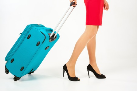 lugage: Woman carries your luggage at the airport terminal. Suitcase. Tourism. Tourist bag. Stewardess. Airlines. Going to plane