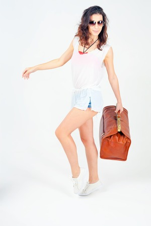 lugage: Happy beautiful woman traveling to to Europe. Going to shopping with bag. She has summer vacation. Travel insurance Stock Photo