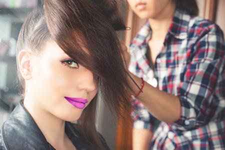 hair saloon: Beautiful young woman at beauty salon. Fashion hairstyle. Make up. Hair saloon