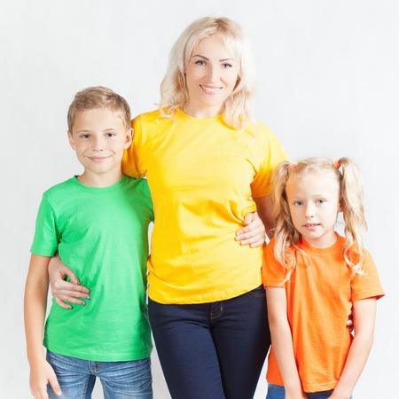 blondy: Happy family with beautiful mother and her children, doughter and son. Family care concept. Love. Mothers care is most important in kids live. White background