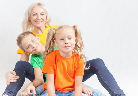 mothercare: Happy family with beautiful mother and her children, doughter and son. Family care concept. Love. Mothers care is most important in kids live. White background