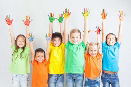 Group of multiracial funny children. Funny kids hands up. World Conference for Well-being of Children in Geneva, Switzerland, at June 1. Universal Children's Day on 20 November.