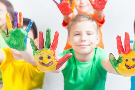 kids painted hands: Happy kids with painted hands on a white background. Smile. International Childrens Day. Painting, occupation