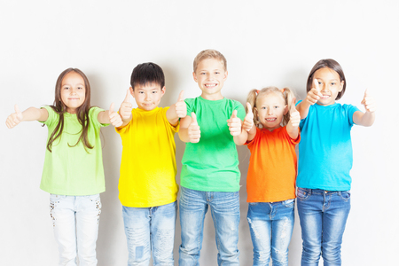 Group of friendly childrens like a team together. Successful young people shows thumb up gesture. Success. Friendship. Kids. Conceptual image Stockfoto