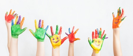 Lot of painted hands raised up. Group of multiracial funny children. Funny kids hands up. World Conference for Well-being of Children in Geneva, Switzerland, at June 1. Universal Children's Day on 20 November