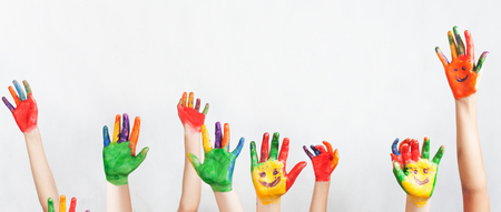 kids painted hands: Lot of painted hands raised up. Group of multiracial funny children. Funny kids hands up. World Conference for Well-being of Children in Geneva, Switzerland, at June 1. Universal Childrens Day on 20 November