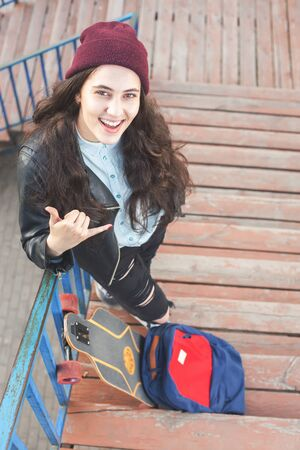 tenager: Cool and funny hipster skateboarder girl with skateboard standing outdoor on stairs. Skatebord at city, street. Cool, Funny Tenager. Austria. Skateboarding at Summer