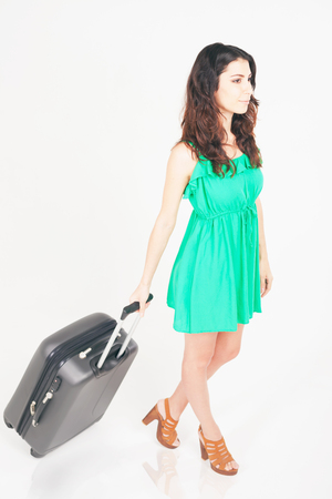 lugage: Woman carries your luggage at the airport terminal. Suitcase. Tourism. Travel and adventure. Tourist bag. Airlines. Going to plane