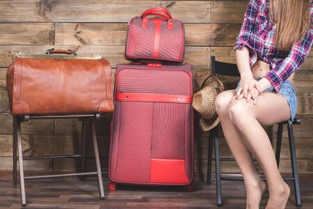'young things': Young woman already packed her things, clothes at luggage, baggage, suitcase. She is going on a journey, vacation. Summer travel. Packs Stock Photo