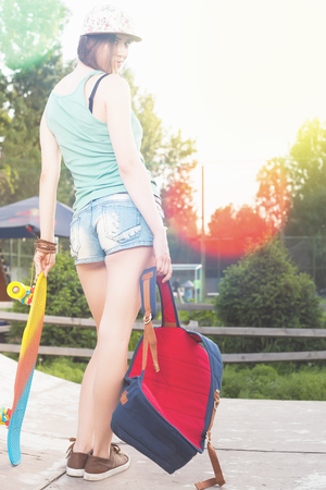 tenager: Close-up fashion skateboarder girl with skateboard outdoor near shop. Skatebord at city, street. Cool, Fun Tenager. Skateboarding at Summer