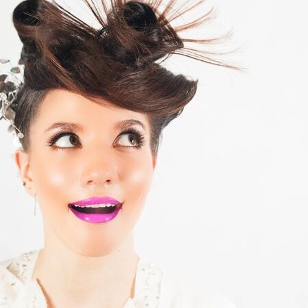 fancy girl: Surprised girl with fancy hairstyle at white background. Fashion, glamour. Wet make-up smokey eyes. Wonder