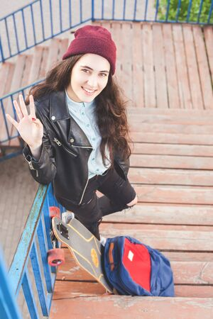tenager: Hipster skateboarder girl with skateboard standing outdoor on stairs. Skatebord at city, street. Cool, Funny Tenager. Austria. Skateboarding at Summer