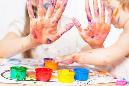enough: Mom and baby draws with colored inks. Closeup hands. Games with child affect early development. Important to spend enough time with your kids.
