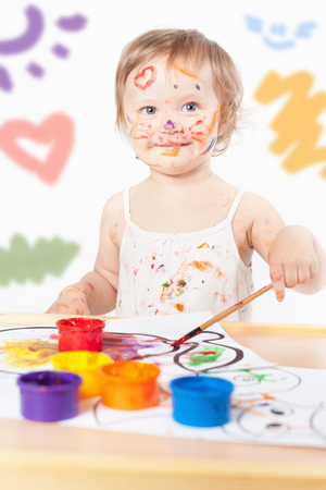 Baby draws with colored inks paint. Games with child affect early development. Important to spend enough time with your kids.