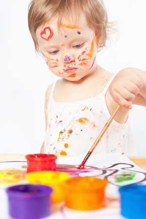 enough: Baby draws with colored inks paint. Games with child affect early development. Important to spend enough time with your kids.
