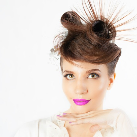 in vouge: Surprised girl with fancy hairstyle at white blurred background. Fashion, glamour. Wet make-up smokey eyes. Wonder