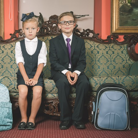 schoolbag: School kids dressed in school uniform, suits. Schoolbag. Back to school! Smart children.