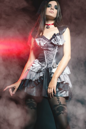 Fashion woman at night club. Celebrating Halloween or New Year! Beautiful costume for carnival. Holiday Stock Photo