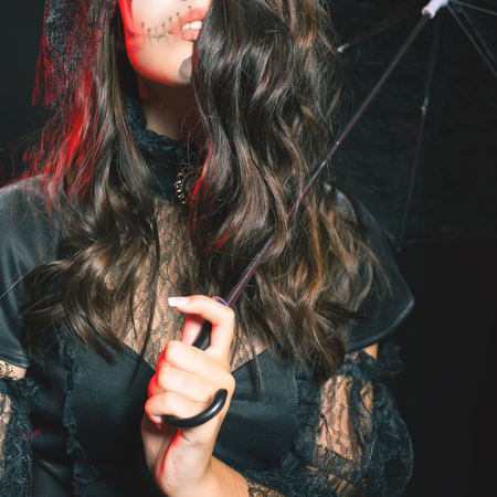 secret code: Closeup fashion young woman going to Halloween party 2016. Beautiful hairstyle and scary makeup! Secret. Doll with umbrella and hat. Halloween costumes. Entrance is limited to nightclub, dress code Stock Photo