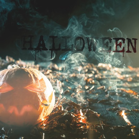 bad habit: Cool pumpkin smoking a cigarette. Halloween pumpkin at wood background with big text of HALLOWEEN. Carved scary faces of pumpcin. October holiday, hllwn. Bad habit