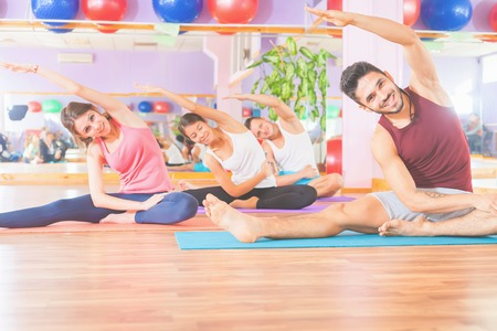 physically fit: Group people doing exercise. Asian man. Healthy lifestyle. Fitness, pilates, any sports activities, healthy body Stock Photo