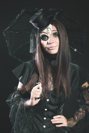 hallowen: Entrance is limited to nightclub, dress code. Fashion young woman going to Halloween party 2016! Beautiful woman like doll with umbrella and hat. Moon, scary cemetery. Hallowen costumes Stock Photo