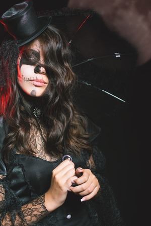 hallowen: Entrance is limited to nightclub, dress code. Fashion young woman going to Halloween party 2016 Beautiful woman like doll with umbrella and hat. Moon, scary cemetery. Hallowen costumes
