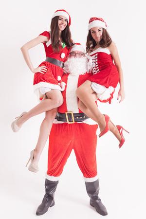 Strong Santa holding a hot girls at the hands. Santa girlfriend. Sexy babes. Christmas party 2016. Celebrating New Year 2017