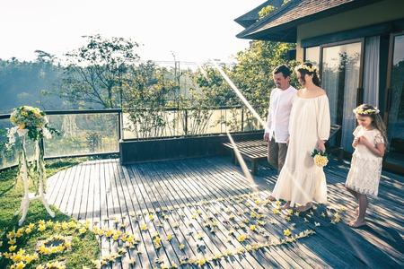 Happy newlyweds couple in marriage, wedding ceremony in Ubud. Reklamní fotografie