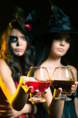 Halloween party 2017 Fashion women like witch holding cocktail