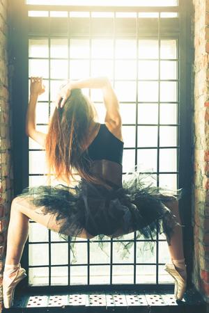 windows: Ballerina dancing indoor, vintage. Healthy lifestyle ballet