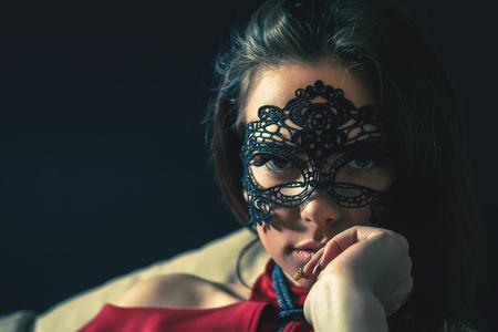Sexy woman with carnival mask. Secret. Fashion. Venetian carnival.