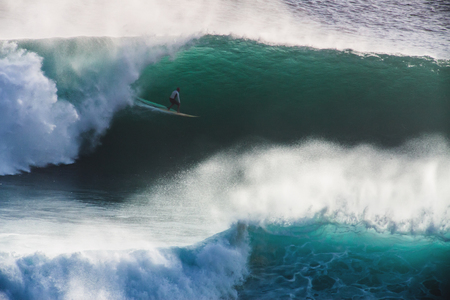 Image Surfer on Blue Ocean Big Mavericks Wave in California 写真素材