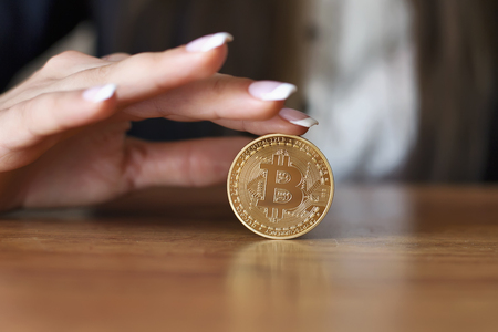 Successfully woman holds a Bitcoin. Crypto coin. Blockchain