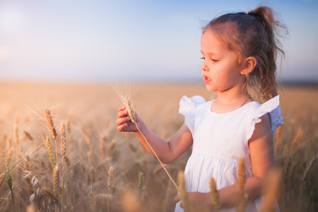 Happy Little Girl Outdoor At Wheat Field. End of Summer Stock Photo