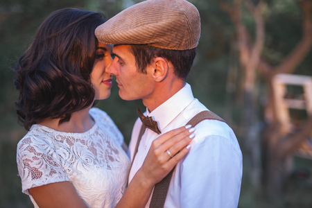 Young Couple Have Got Marriage In Rustic Style In Apple Orchard