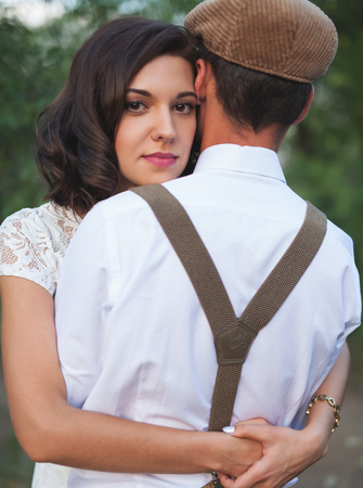 Young Couple Have Got Marriage In Rustic Style In Field