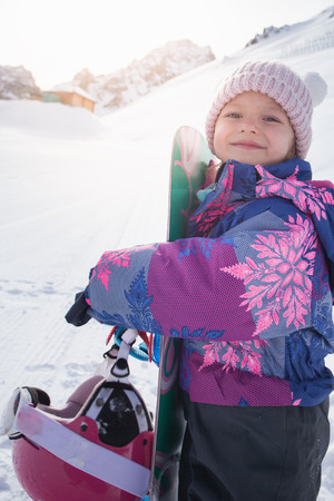 Your happy kid has ski or snowboard lesson at alpine school. Stock Photo