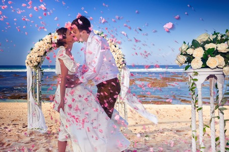 Wedding couple just married at the beach, Bali Banco de Imagens - 115841592