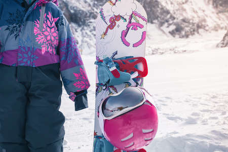 Your happy kid has ski or snowboard lesson at alpine school Zdjęcie Seryjne