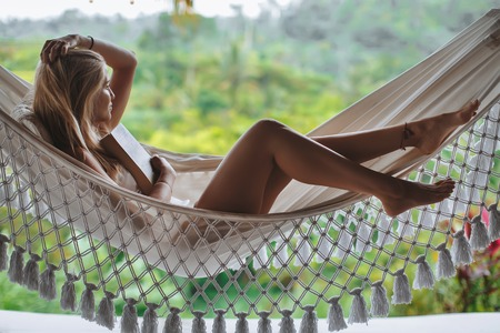 Healthy sleep in the open air at hammock. Sexy woman relaxing