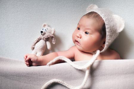 newborn baby asian boy sleeping at blue background