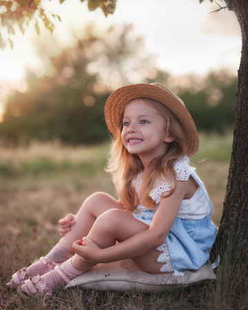 Summer outdoor portrait of beautiful happy child