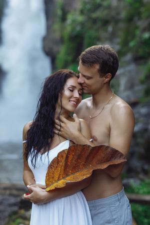Sexy couple traveling at Bali, Ubud near big waterfall