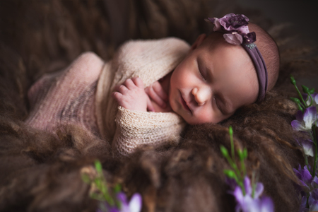 Infant baby girl sleeping at background. Newborn and mothercare concept Zdjęcie Seryjne