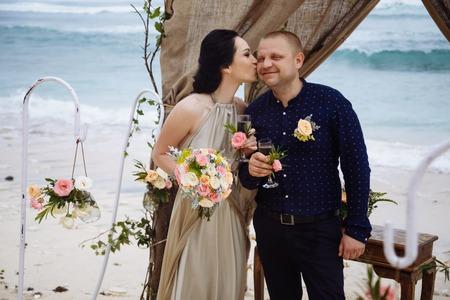 Beautiful couple near the ocean, honeymoon romantic couple