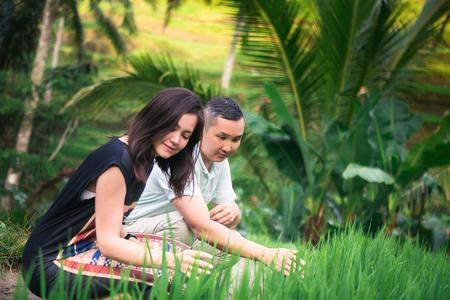 Happy couple traveling at Bali, rice terraces of Tegalalang, Ubud